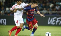 Sevilla's Ever Banega (L) chases Barcelona's Lionel Messi during their UEFA Super Cup soccer match at Boris Paichadze Dinamo Arena in Tbilisi, Georgia, August 11, 2015. REUTERS/Grigory Dukor
