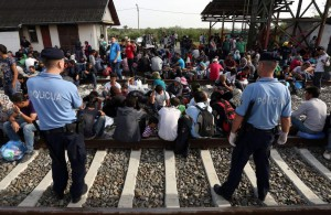 TOPSHOTS Migrants wait for a train at  a railway station, near the official border  between Serbia and Croatia, near Eastern-Croatian town of Tovarnik, on September 17, 2015. Migrants headed for Western-European countries have found a new route between countries to cross into the EU, after Hungarian authorities have physicaly closed it's borders towards Serbia. For the moment, Croatia copes well with the influx of refugees, being still able to keep evidence of the people arriving and transporting them by train to refugee transit centres closer to nation's capital, Zagreb. AFP PHOTO/STRSTR/AFP/Getty Images