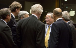 Greek Foreign Minister Nikos Kotzias, third right, speaks with, from left, Slovenian Foreign Minister Karl Erjavec, Dutch Foreign Minister Bert Koenders, Belgian Foreign Minister Didier Reynders, Finnish Foreign Minister Erkki Tuomioja and French Secretary of State for Foreign Affairs Harlem Desir during a meeting of EU foreign ministers at the EU Council building in Brussels on Thursday, Jan. 29, 2015. EU foreign ministers hold an extraordinary meeting on Thursday to discuss the latest fighting in Ukraine and possible further sanctions against Russia. (AP Photo/Virginia Mayo)