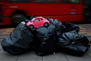 A toy model of a Volkswagen Beetle is seen on top of bags of rubbish ready for collection by waste collectors early in the morning outside a charity shop in London, United Kingdom, in this April 22, 2013 file photo.  REUTERS/Russell Boyce/Files
