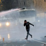 Riot police use water cannon to disperse demonstrators during a protest against the curfew in Sur district in the Kurdish dominated southeastern city of Diyarbakir