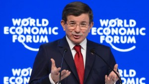 Turkish Prime Minister Ahmet Davutoglu addresses the assembly during the World Economic Forum (WEF) annual meeting in Davos, on January 21, 2016.  Rising risks to the global economy and a string of jihadist attacks around the world overshadowed opening of an annual meeting of the rich and powerful in a snow-blanketed Swiss ski resort. / AFP / FABRICE COFFRINI