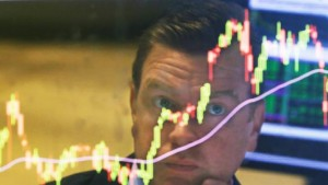 FILE - In this Aug. 25, 2015 file photo, specialist Michael O'Mara works on the floor of the New York Stock Exchange, in New York. As stocks swung wildly last month, average investors pulled a net $9.8 billion out of mutual funds targeting U.S. stocks and put $9 billion in the money market during the week ending Aug. 26, according to the Investment Company Institute, a trade group. The next week, the market rebounded and they reversed course, sticking $1.8 billion into U.S. funds.  (AP Photo/Richard Drew, File)