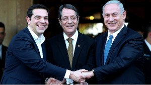 Cypriot president Nicos Anastasides, centre, Greek Prime Minister Alexis Tsipras, left, and  Israeli Prime Minister Benjamin Netanyahu shake hands after leaving their meeting from the presidential palace in capital Nicosia in the Mediterranean island of Cyprus, Thursday, Jan. 28, 2016. The leaders of Cyprus, Greece and Israel met in the Cypriot capital with the aim to strengthen cooperation and bolster stability in a region wracked by conflict. The talks are the first tripartite summit. Discussions will cover newly found offshore gas reserves and tourism, while the leaders will sign a cooperation agreement on water resources. (AP Photo/Petros Karadjias)