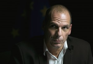 Greek Finance Minister Yanis Varoufakis arrives at a news conference after an extraordinary euro zone Finance Ministers meeting (Eurogroup) in Brussels February 20, 2015. Varoufakis said a deal reached with euro zone finance ministers on Friday that extended its international bailout program by four months would allow Greece to rebuild its ties with its EU partners. REUTERS/Yves Herman (BELGIUM - Tags: POLITICS BUSINESS)