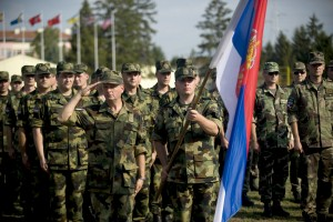 Serbian military members render salutes to the guests of honor Sept. 3, 2009, during the conclusion of the opening ceremonies for Combined Endeavor 2009 at Kozara Barracks, Banja Luka, Bosnia-Herzegovina. Combined Endeavor 2009 is a Headquarters U.S. European Command-sponsored communications and information systems interoperability test between and among Partnership for Peace and NATO nations. (U.S. Air Force photo by Tech. Sgt. William Greer/Released)