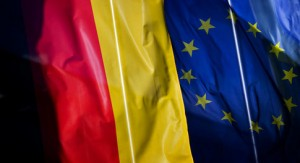 A German (L) and a European flag wave in front of a company in Dresden, Germany, 20 October 2011. Photo: Arno Burgi