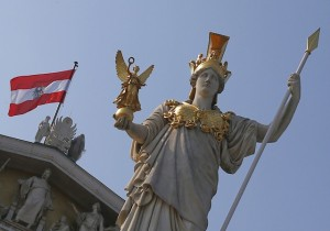 The Austrian national flag is seen at the Austrian Parliament next to the statue of Greek goddess Pallas Athena in Vienna on September 5, 2012. AFP PHOTO / ALEXANDER KLEIN (Photo credit should read ALEXANDER KLEIN/AFP/Getty Images)