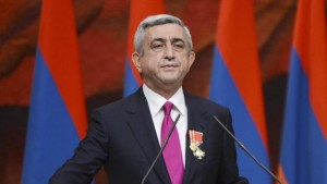 FILE - In this file photo taken on Tuesday, April 9, 2013, Armenian President Serge Sarkisian is sworn in during his inauguration ceremony in Yerevan, Armenia, Tuesday, April 9, 2013. Armenia was holding a referendum Sunday on proposed constitutional changes that would give more powers to the prime minister and parliament at the expense of the president, who would become largely a figurehead, but the opposition has seen the reform as an attempt by President Serzh Sargsyan to extend his rule. (AP Photo/Davit Hakobyan, PanARMENIAN, File)