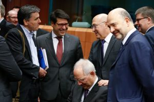 epa05154462 French Finance Minister Michel Sapin (3-R) reacts with German Finance Minister Wolfgang Schaeuble (C) next to Greeks Finance Minister Euclid Tsakalotos (L) and European Commissioner for Economic and Financial Affairs Pierre Moscovici (R), during a Eurogroup Finance ministers meeting at the European Council headquarters in Brussels, Belgium, 11 February 2016. The Eurogroup meeting's agenda is reported to be topped by the Portuguese draft budget, the Greek programme and general economic issues in the eurozone. EPA/LAURENT DUBRULE