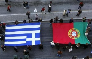 Protesters carry flags of Portugal (R) and Greece as they march through Athens' Syntagma square during an anti-austerity rally November 14, 2012. REUTERS/Yannis Behrakis