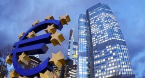 The Euro sculpture stands in front of the European Central Bank, right,  in Frankfurt, Germany, on Friday, Dec.16, 2011.(AP Photo/Michael Probst)