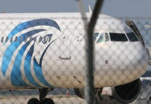 FILE - In this Tuesday, March 29, 2016, file photo, the hijacked aircraft of Egyptair after landing at Larnaca airport, Cyprus.  A similar Airbus A320 EgyptAir plane from Paris to Cairo carrying 66 people disappeared from radar early Thursday morning, the airline said. EgyptAir Flight 804 was lost from radar at 2:45 a.m. local time when it was flying at 37,000 feet, the airline said. It said the Airbus A320 had vanished 10 miles (16 kilometers) after it entered Egyptian airspace. (AP Photo/Petros Karadjias, File)