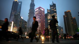 In a global survey, many respondents believe that China has overtaken or eventually will overtake the U.S. as the world's leading superpower. Chinese are shown here walking in Shanghai's financial district in March.