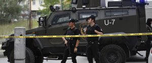 Turkish police officers secure the area at the site of a blast, in Istanbul, Thursday, May 12, 2016.  A car bomb targeting a vehicle carrying military personnel lightly wounded several people Thursday, an official said. The explosion occurred inside a car close to the entrance of a military garrison in Istanbul's Sancaktepe neighborhood at the start of the evening rush hour. None of the injured were in a serious condition. (AP Photo)