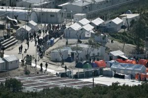 epa05244790 A general view over the hotspot refugee camp, formerly a detention centre, in Moria, Lesvos island, Greece, 05 April 2016. Migrants who refuse to apply for asylum are to be deported to Turkey, in accordance with a tit-for-tat agreement between European Union and Turkey on the refugee and migration crisis. EPA/ORESTIS PANAGIOTOU
