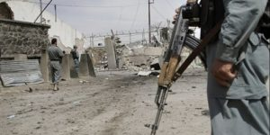 afghan-policeman-secures-the-area-outside-a-compound-after-it-was-attacked-by-taliban670