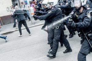 epa05357270 Austrian riot police clash with protesters during a demonstration against the 'Defend Europe' rally of the Identity Movement Austria, in Vienna, Austria, 11 June 2016. The Identity Movement is a political movement of people which believes that foreign cultures should be kept away from their own, in order to preserve an ancestral identity. EPA/CHRISTOPHER GLANZL