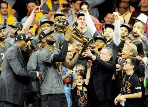 Jun 19, 2016; Oakland, CA, USA; Cleveland Cavaliers forward LeBron James (23) celebratew with the Larry O'Brien Championship Trophy after beating the Golden State Warriors in game seven of the NBA Finals at Oracle Arena. Mandatory Credit: Gary A. Vasquez-USA TODAY Sports