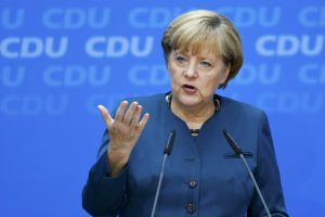 German Chancellor and leader of the Christian Democratic Union ( CDU) Angela Merkel addresses a news conference after a CDU party board meeting in Berlin September 23, 2013, the day after the general election. Merkel faces the daunting prospect of persuading her centre-left rivals to keep her in power after her conservatives notched up their best election result in more than two decades but fell short of an absolute majority.               REUTERS/Kai Pfaffenbach (GERMANY  - Tags: POLITICS ELECTIONS)