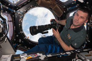 ISS-47_Yuri_Malenchenko_with_camera_in_the_Cupola_module