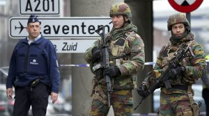 Belgian troops and police control a road leading to Zaventem airport following Tuesday's airport bombings in Brussels