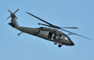 A U.S. Army UH-60 Black Hawk helicopter assigned to the 159th Combat Aviation Brigade, 101st Airborne Division, flies off after unloading Soldiers at a drop point during air assault demonstration training at Campbell Army Airfield aboard Fort Campbell, Ky., Aug. 7, 2012. Soldiers were preparing a demonstration for the upcoming Week of the Eagles Air Show. (U.S. Army photo by Sam Shore/Released)