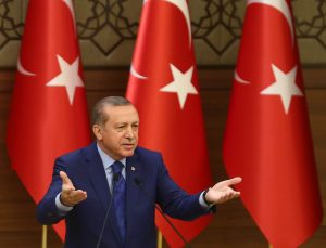 Turkish President Recep Tayyip Erdogan gestures as he delivers a speech during the mukhtars (local town government heads) meeting at the Presidential Complex in Ankara on March 16, 2016.  / AFP / ADEM ALTAN        (Photo credit should read ADEM ALTAN/AFP/Getty Images)