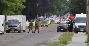 Police gather evidence outside of a house a day after a stand-off with authorities in Strathroy Ontario, Canada Thursday, Aug. 11, 2016. Suspect Aaron Driver was killed in a confrontation with police.   (Dave Chidley/The Canadian Press via AP)