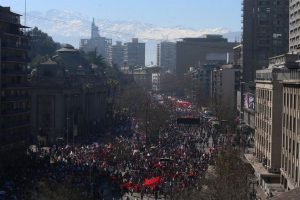 Thousands march against Pension Fund Administrators demanding an end to the system due to low pensions, in Santiago, Chile, Sunday, Aug. 21, 2016. There were demonstrations and marches in several other cities around the country. (AP Photo/Esteban Felix)