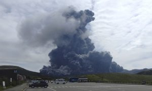 In this photo released by Aso Volcano Museum, a column of black smoke rises from Mount Aso on the southern Japanese island of Kyushu Monday, Sept. 14, 2015. The volcano has erupted, sending huge plumes of black and then white smoke 2,000 meters (6,560 feet) into the air. (Aso Volcano Museum via AP)