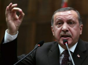 Turkey's Prime Minister Recep Tayyip Erdogan addresses the lawmakers of his Islamic-rooted Justice and Development Party at the parliament in Ankara, Turkey, Tuesday, Feb. 16, 2010.(AP Photo)