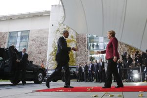 U.S. President Barack Obama is welcomed by German Chancellor Angela Merkel upon his arrival at the chancellery in Berlin, Germany, November 18, 2016. REUTERS/Fabrizio Bensch