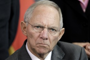 German Finance Minister Wolfgang Schaeuble attends a joint news conference with Chancellor Angela Merkel on the upcoming G-20 summit at the Chancellery in Berlin, Germany, Wednesday, Nov. 10, 2010. (AP Photo/Michael Sohn)