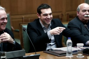 Greek Prime Minister Alexis Tsipras (C) attends a cabinet meeting in the Greek parliament in Athens on March 29, 2015. AFP PHOTO/ ANGELOS TZORTZINIS        (Photo credit should read ANGELOS TZORTZINIS/AFP/Getty Images)