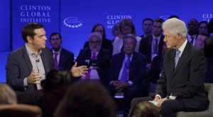 Greek Prime Minister Alexis Tsipras, left, participates in an interview with former President Bill Clinton, Sunday, Sept. 27, 2015 at the Clinton Global Initiative in New York. (AP Photo/Mark Lennihan)