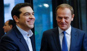 epa04603155 President of the European Council, Polish, Donald Tusk (R) welcomes Greek Prime Minister Alexis Tsipras prior to a meeting at EU council  headquarters in Brussels, Belgium, 04 February 2015.  EPA/OLIVIER HOSLET
