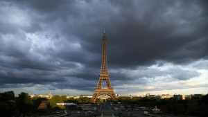 The Eiffel Tower is seen under clouds in Paris