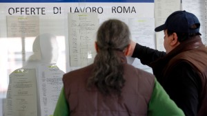 Jobseekers browse job notices displayed on a board inside an employment center in Rome, Italy, on Tuesday, Feb. 28, 2012. Italian business confidence unexpectedly fell to a two-year low in February after the economy entered its fourth recession since 2001 under the weight of austerity measures to fight the sovereign debt crisis. Photographer: Alessia Pierdomenico/Bloomberg via Getty Images