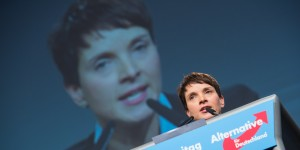 "HANOVER, GERMANY - NOVEMBER 28:  Chairwoman Frauke Petry delivers her speech during the AfD (Alternative fuer Deutschland) federal party congress on November 28, 2015 in Hanover, Germany. The AFD aims to enter three new state parliaments in 2016 by luring conservative voters angry with Chancellor Angela Merkel's open-door asylum policy. This weekend the party will outline its plan to bring order to what it calls the ""asylum chaos."" (Photo by Nigel Treblin/Getty Images)"