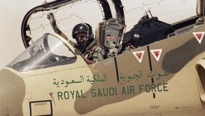 A pilot of the Royal Saudi Air Force waves to ground personnel to take off in his American made F-15 Eagle Fighter Jet on Wednesday, August 15, 1990 at an Air Base in Saudi Arabia. The Saudi Air Force is being augmented by American Air Power as they prepare to defend against the Iraqi military threat. (AP Photo/Scott Applewhite)