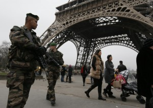 """French soldiers patrol near the Eiffel Tower in Paris as part of the highest level of """"Vigipirate"""" security plan after a shooting at the Paris offices of Charlie Hebdo January 7, 2015. Gunmen stormed the Paris offices of the weekly satirical magazine Charlie Hebdo, renowned for lampooning radical Islam, killing at least 12 people, including two police officers in the worst militant attack on French soil in recent decades. The French President  headed to the scene of the attack and the government said it was raising France's security level to the highest notch. REUTERS/Gonzalo Fuentes  (FRANCE - Tags: CRIME LAW MILITARY)"""