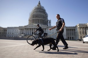 U.S. Capitol Police officers keep watch over the East Front of the Capitol as Congress prepares to return to work following the weekend terror attacks in Paris that killed 129 people, in Washington, Monday, Nov. 16, 2015. President Barack Obama conceded that the attacks were a setback in the fight against the Islamic State, but dismissed critics who have called for the U.S. to change or expand its military campaign against the extremists. (AP Photo/J. Scott Applewhite)