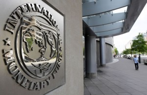 Pedestrians walk past the International Monetary Fund headquarters' complex in Washington Sunday, May 2, 2010. A senior International Monetary Fund official says the IMF's executive board is meeting in Washington to consider how much aid to grant Athens under a massive rescue loan package. (AP Photo/Cliff Owen)