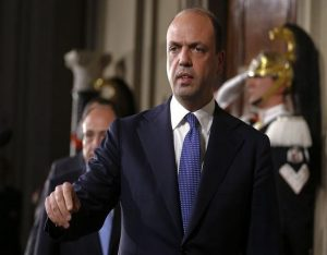 Italy's Interior Minister and leader of New Center Right party Angelino Alfano arrives to talk to reporters at the end of the consultations with Italian President Giorgio Napolitano at the Quirinale Palace in Rome February 15, 2014. Italy's president may ask young center-left leader Matteo Renzi to become its youngest ever prime minister this weekend after a party coup that forced Enrico Letta to resign as premier of the euro zone state struggling to pull out of recession. REUTERS/Tony Gentile (ITALY - Tags: POLITICS)