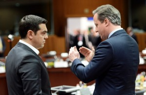 Greece's Prime Minister Alexis Tsipras (L) talks with Britain's Prime Minister David Cameron during an EU summit meeting, at the European Council in Brussels, on February 18, 2016. EU leaders head into a make-or-break summit sharply divided over difficult compromises needed to avoid Britain becoming the first country to crash out of the bloc. / AFP / POOL / STEPHANE DE SAKUTIN