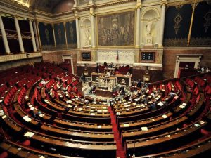 The French parliament debate to ban women from wearing full Islamic veils in public.