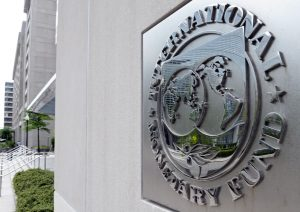 The International Monetary Fund headquarters is seen in Washington, Sunday, May 2, 2010. A senior International Monetary Fund official says the IMF's executive board is meeting in Washington to consider how much aid to grant Athens under a massive rescue loan package. (AP Photo/Cliff Owen)