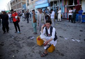 CAPTION CORRECTION: CORRECTS NAME OF PHOTOGRAPHER TO MASSOUD HOSSAINI -- A bloodied man who carried dead and wounded, speaks on the phone at the site of a suicide attack an explosion that struck a protest march, in Kabul, Afghanistan, Saturday, July 23, 2016. Witnesses in Kabul say that an explosion causing multiple casualties struck the march by members of Afghanistan's largely Shiite Hazara ethnic minority group, who were demanding that a major regional electric power line be routed through their impoverished home province. (AP Photo/Massoud Hossaini)