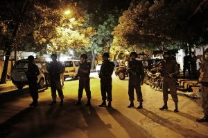 epa05402247 Bangladeshi security forces stand guard as they seal off the streets close to a Spanish resturant, following a hostage taking, in Dhaka, Bangladesh, late 01 July 2016. Two police officials have been killed during the encounter while some gunmen reportedly took several people hostage, including some foreigners, inside a Spanish resturant. The law inforcement officials try to negotiate with the gunmen while the US-based SITE Intelligence Group quoted the Amaq News Agency as saying that fighters of the terrorist organisation 'Islamic State' (IS) carried out the attack. EPA/STRINGER